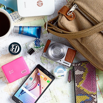 Travel Essentials — Find everything from cameras to comfy kicks