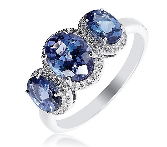 2.50ct AAA Oval Tanzanite & 0.15ct Diamond Trilogy Halo Ring 18ct Gold