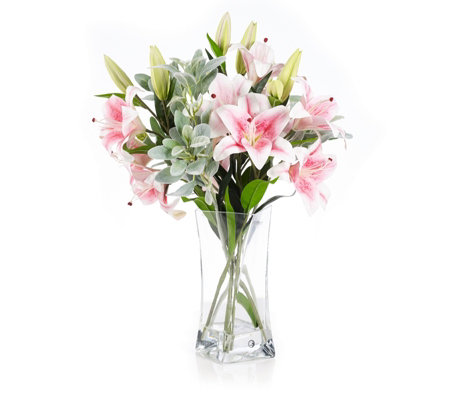 Peony Lilies & Foliage in a Clear Twisted Vase